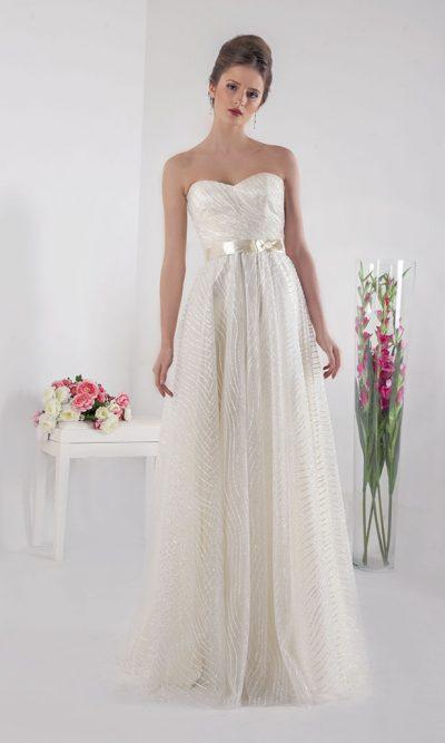 Společenské šaty vanilkové barvy a třpytkama