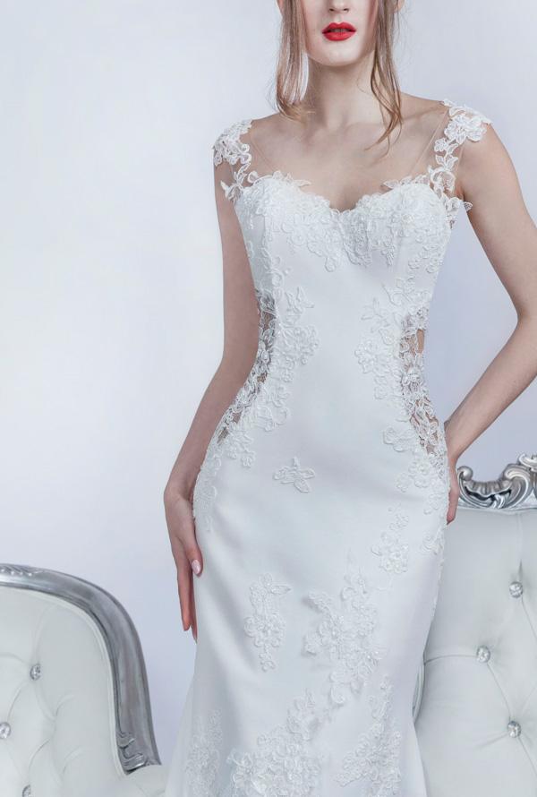 Elegantní svatební šaty zdobené ručně vyšívanou krajkou