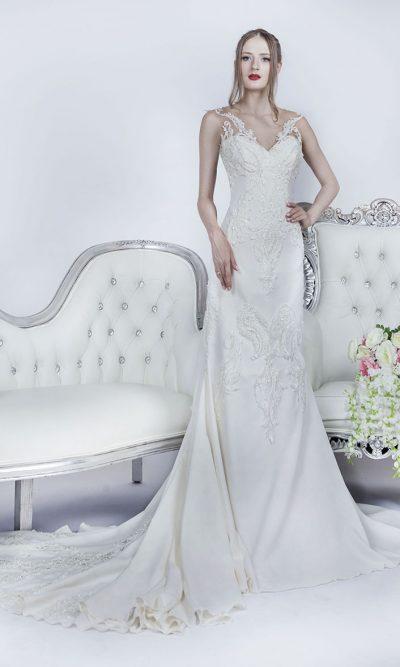 Svatební šaty se symetrickou výšivkou