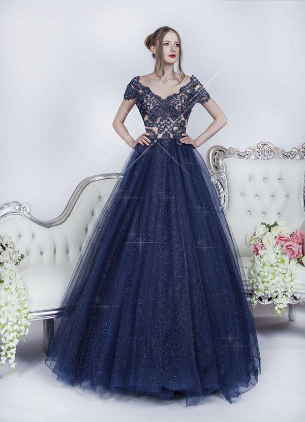 Třp\tivé tmavě modré plesové šaty s průhledným vrškem