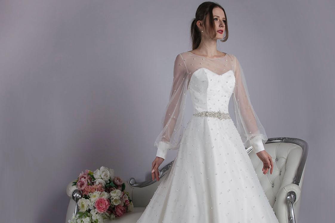 Svatební šaty s rukávy pro svatbu v zimě